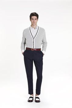 Blue striped pants go well with a check button-down shirt and a cardigan with the same motif and contrasting borders. Tuck in the #shirt and #cardigan to up the formal quotient #ss15 #checks #stripes #menswear