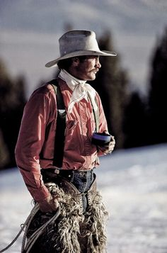 Cowboy with coffee in the snow