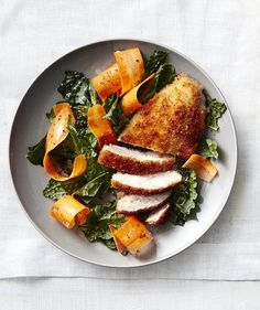 Crispy Chicken Cutlets With Carrot and Kale Salad | Get the recipe for Crispy Chicken Cutlets With Carrot and Kale Salad.