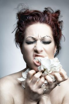 Amanda Palmer eating flowers.