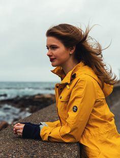 KJP beach ocean wall yellow rain jacket storm stormy stripes stripe navy jeans jcrew j.crew narragansett rhode island seawall April Showers