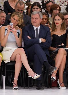Jennifer Lawrence and Emma Watson at Christian Dior show on July 7, 2014 in Paris, France