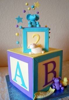 Blocks baby shower cake soo freaking cute I love this cake my favorite!!!!