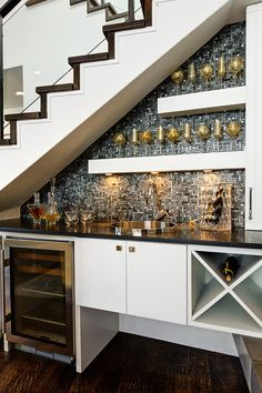without the glitter, love the idea of turning the under-stair space into a bar area
