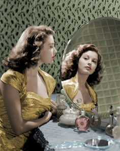 a young 1940's Ava Gardner at the vanity table. Boudoir.