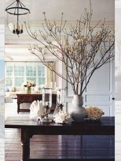 Dark coastal hues, decorating with coral, glass and twigs
