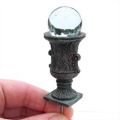 Nicely detailed and painted by hand to look aged and weathered, this miniature garden gazing globe will add a touch of elegance to your mini or fairy garden.