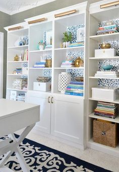Home office with white bookcases