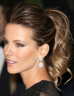 We're handling the hairstyle aspect for your big night. All you need to do is browse through the pictures below and choose! It's 2014; updos are not the on