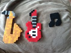 I know this is not art but I made these out of perler beads of the instruments I play -Raina