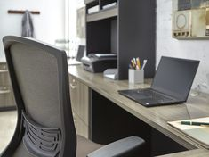 A gray office set up fit for a busy entrepreneur. The Sauder Via in its Hudson Elm finish is exclusive to National Business Furniture. | Executive Office | #MyNBFStyle #executive #officeinspo #officeideas #manageroffice #corneroffice