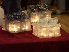 Glass Blocks. They are so pretty under the tree or just sitting on end tables, etc. The pretty see through wire edged ribbons make the most beautiful bows.