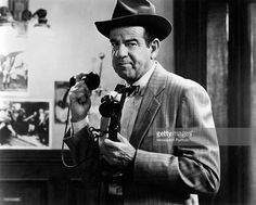 American actor Walter Matthau (Walter John Matthow) holding a telephone in the film The Front Page. USA, 1974