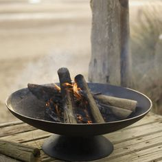 This handsome and substantial iron brazier is a warming addition to any garden. You can use it day or night, for decoration or for real heat. It's great for those cooler evenings and is a striking centrepiece on any decking or terrace for everyone to gather around. £88.