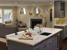 Kitchen Island with Sink - 99 Beautiful Kitchen Island Design Ideas on HGTV.  bringing grey from living room