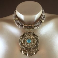 """Necklace Set 14""""L, 2-row corded choker with 4""""L drop gold tone textured round metal medallion with metal diamond cut fringe. 3""""L extender chain attached for ease of use. Matching pair of pierced (fish hook) earrings. Jewelry Necklaces"""