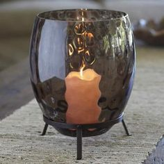 $40 Dramatic glass hurricane reveals a moody gray color and unique textured surface when lit by a pillar candle, Escential jar or tealight tree