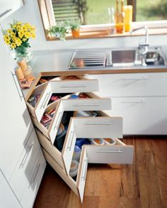 Great use of space!! Absolutely love this instead of cabinet with lazy Susan!! More space used instead of wasted!!!