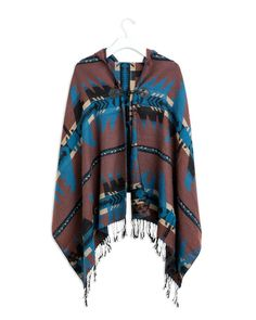 The Woodstock Poncho - Hooded tribal print shawl with closure at neck. Tassel details on bottom hem.