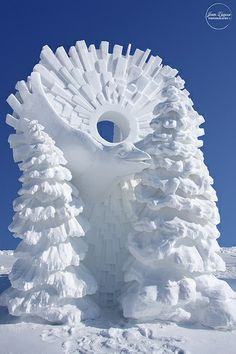 Snow sculpture ... bird, trees, sunburst