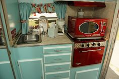 vintage travel trailer - turquoise and red kitchen