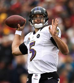 Baltimore Ravens quarterback Joe Flacco throws a touchdown pass against the Washington Redskins in the first half of their NFL football game in Landover, Maryland December 9, 2012. REUTERS/Gary Cameron (UNITED STATES - Tags: SPORT FOOTBALL)