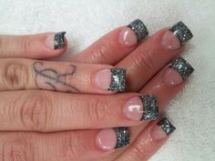 Black tips with clear glitter..Bling Bling.Bling...Beaumont Top Nails & Spa..