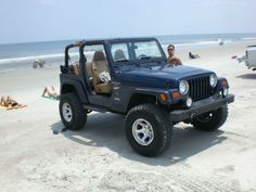 I have always wanted a navy blue jeep and it's on the sand which is even better!!