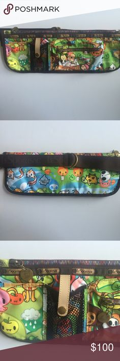"""Lesportsac Tokidoki Canguro Fanny Pack / Wait Bag This like-new Lesportsac Tokidoki Canguro fanny pack is adorable! Limited edition and ultra rare collectable piece. You can strap on this waist pouch bag and you're good to go! ✌🏼️  • Top zippered main closure with 2 front sash pockets • Adorable rainbow metal zippers with embossed metal pulls • Adjustable waist strap/belt with silver-toned hardware (fits waist size up to 40"""" to 42"""") • Metallic carabinier inside on a stretch cord • Orange…"""