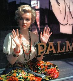 Marilyn Monroe photographed by Milton Greene, 1956 in Fortune Telling Storefront Window | Palm Reading | Psychic