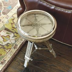 We haven't met a man yet who doesn't want this table. A great gift for his study or office, the compass face is etched metal and really works, so he'll always know true North. The legs adjust to the perfect height for parking a drink beside his favorite chair.