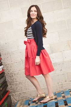 Ack so cute! Solid skirt, striped top, cardi. Also, I'm loving her hair.