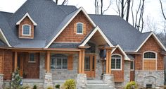 Arts & Crafts Style Home with Stained Cedar Shakes