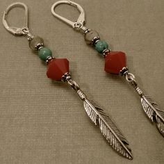 Sterling Silver Feather Charms USA Dark Red Coral Crystal Beads- Swarovski Turquoise Beads Faceted Glass Beads- Czech Republic Antique Silver-Plated Bead Caps- TierraCast® Secure Sterling Silver Leverback Earrings The earrings are 2 inches cm) long. Beaded Jewelry Designs, Wire Jewelry, Boho Jewelry, Jewelery, Indian Jewelry, Jewelry Ideas, Diy Schmuck, Schmuck Design, Feather Earrings