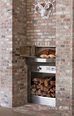 A brick surround houses the Wood Stone Bistro Oven—a gas-and wood-fired pizza oven. - Photo: Ryann Ford / Design: Julie Dodson