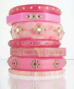 A stack of amazing icy pink bangles. So much pretty detail on each one. Know where to get these? The source is a blog that doesn't provide a credit.