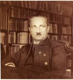 "Martin Heidegger (seen here sporting a Hitler stache before it ""went mainstream"") postulates in ""Being and Time"" (1927) a theory of existential philosophy which asserts that everyone is, by the nature of ""Being-in-the-world"", destined to live and die alone. Woof! It's not all bad though: the 'meaning of life' can be understood as acknowledging the ""lonely"" struggle of others and exhibiting ""care""."