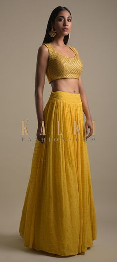 Buy Online from the link below. We ship worldwide (Free Shipping over US$100)  Click Anywhere to Tag Pineapple Yellow Skirt And Crop Top With Short Embellished Jacket Online - Kalki Fashion Pineapple yellow skirt in georgette with sequins embellished buttis.Paired with a matching crop top in raw silk adorned with beads and sequins embellished checks pattern.Crafted sleeveless with round neckline and key hole cut back.