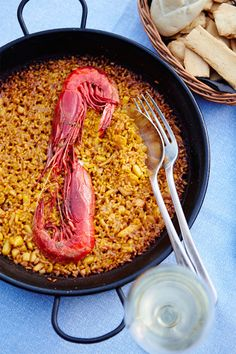 A seafood paella dish at moorish-tiled restaurant La Mar in Madrid, one of the best places in Spain to taste the country's wealth of culinary specialties // photo by Matt Munro #paella #spain #madrid #seafood #food