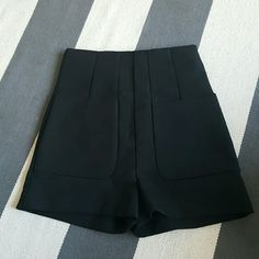 H & M 4 black high waisted shorts Never worn Size 4 High waisted tailored shorts 74% polyester  22% viscose H&M Shorts