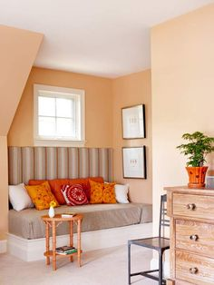 Like the sun setting over a desert, this comfy bedroom nook welcomes evening shades in dusky hues of desert sand, golden orange, and red. The warm wall color bridges the spectrum between the brown furnishings, striped fabrics, and the brighter accessory colors./