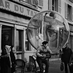 Melvin Sokolsky 1963 Harper's Bazaar | Simone D'Aillencourt floating in a bubble through Parisian streets and sights