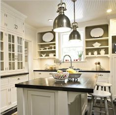 white kitchen cabinets w/ pendant lights