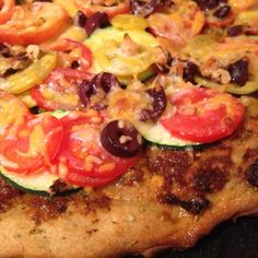 Kristen/Liz Collaboration: Homemade pizza: pesto, sundried tomatoes, zucchini, tomatoes, olives, walnuts...yum!