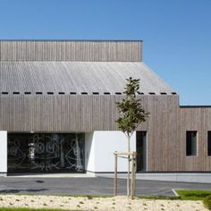 """Timber-clad kindergarten with """"the silhouette of a house"""" by Topos Architecture"""
