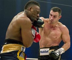 Vitali Klitschko against Dereck Chisora for the WBC heavyweight championship of the world.    Image shows Chisora being hit clean by a big right in round nine.