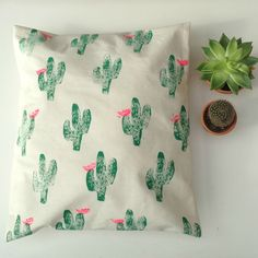 Hand printed cactus pillow.