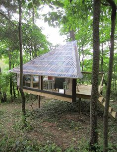 The triangular Wolfe's Den, designed and built by Diedricksen, is an elevated, 75-square-foot structure with a deck in New Paltz, New York, which the owner uses as a reading room and sleep space for her nephews.