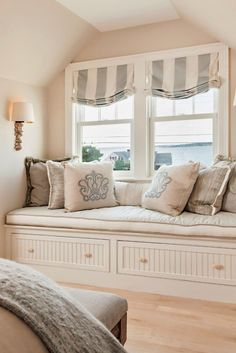 comfy window seat | Casabella Home Furnishings and Interiors Lovely use of neutrals and light colors to stay modern yet cozy