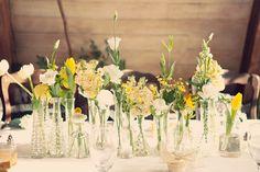 single flowers in bud vases-so darling
